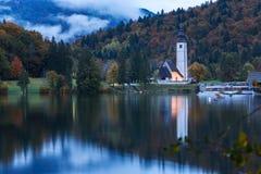 Church tower and stone bridge at Lake Bohinj Royalty Free Stock Photos