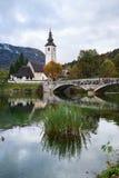 Church tower and stone bridge at Lake Bohinj Stock Image