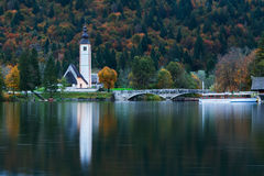 Church tower and stone bridge at Lake Bohinj Stock Photos