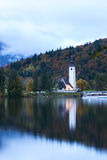 Church tower and stone bridge at Lake Bohinj. In alpine village Ribicev Laz, Slovenia Stock Image