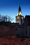 The church tower and the stonewall at dusk Royalty Free Stock Photo