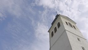 Church tower on a sunny day. Action. White Church steeple on background of blue sky.  stock footage