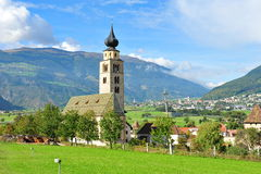 Church tower surrounded by beautiful mountain landscape. In Switzerland Royalty Free Stock Photo