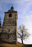 Church Tower and Tree. Old church tower and tree in Zahořany, Czech republic Royalty Free Stock Photography