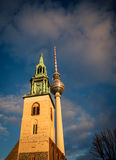 Church tower and tv tower Stock Photos