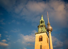 Church tower and tv tower Royalty Free Stock Images