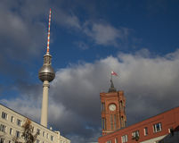 Church tower and tv tower Stock Images