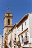 Church tower and white houses at the central square of Requena Stock Photography