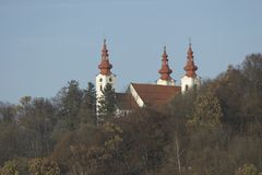 Church With Towers. Church with tree towers in a cluster of trees royalty free stock photo