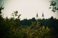 Church. The towers of church above the forest in Vilnius, Lithuania Royalty Free Stock Photos