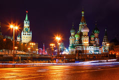 Church and towers of Kremlin at night. view from Bolshoi Zamoskvoretsky bridge. Tracers from cars. Stock Photos