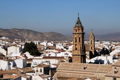 Church towers and town rooftops, Antequera, Spain. Stock Photos