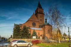 Church of the Most Holy Trinity in Bogdanowo, Poland. Church in the town of Bogdaná illuminated by the autumn sun, Poland Royalty Free Stock Image