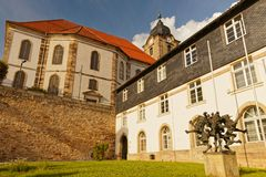 Church and town hall in Hildburghausen. View to new town hall and christus church in the small town Hildburghausen in south thuringia, in front is a statue of royalty free stock image