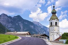 Church in town of Pontebba, Italy. View from the Bicycle road Alpe Adria in Italian Alps.  royalty free stock image