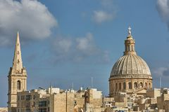 Church and traditional architecture in Valletta in Malta.  Royalty Free Stock Images