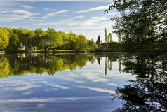 Church and Trees reflected in still lake Royalty Free Stock Photography