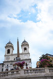 The church of Trinite dei Monti at the top of the Spanish Steps with its Egyptian obelisk in Rome Italy. Rome Italy, the Eternal city, which has been a Stock Photography