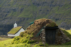 Church and turf house at Saksun. Faroe Islands Royalty Free Stock Photo