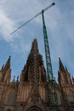 Church under construction. A church under construction with a tower crane in front Stock Images