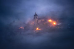 Church under fog at night in Aramaio Royalty Free Stock Images