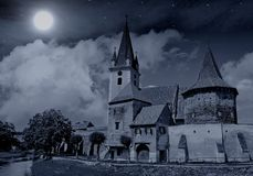 Church under full moon and stars stock photography