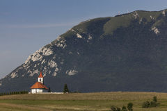 Church under mountain Nanos, Slovenia Stock Image