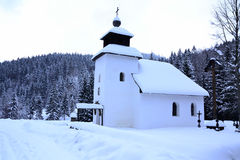 Church. Under the mountains in Slovakia during the harsh winter royalty free stock photos