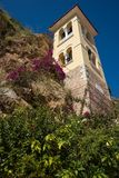 Church under the rock, river and flowers near Kefalary on Peloponnese in Greece. Image of church under the rock, river and flowers near Kefalary on Peloponnese stock photo