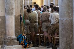 Church Vezelay Service Scouts France. Vezelay, France - July 29, 2018: Church service with boy scouts in the romanesque church and abbey of Vezelay in Yonne royalty free stock photo