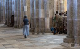 Church of Vezelay with Service and Scouts. Vezelay, France - July 29, 2018: Church service with boy scouts in the romanesque church and abbey of Vezelay in Yonne royalty free stock photography
