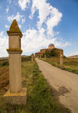 Church with Via Crucis pilar. The Church of Villaroya de los Pinares with a row of Via Crucis pilars on the access road at the province of Teruel in Aragon Stock Images