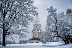 Church view through the trees in winter snowfall. The Church of the ascension in Kolomenskoye. Moscow, Russia stock image