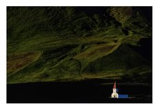 Church in Vik, Iceland. Capture in great light with the white church towards the dark green mountain grass,tower,nature,landscape Stock Photos