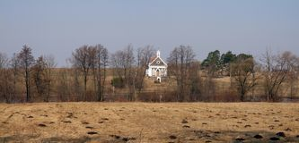 Church in village. White church in Lithuania nearby Panevezys city Royalty Free Stock Image