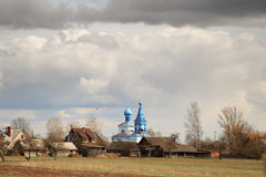 Church in a village against a dramatic sky background Stock Photography