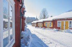 The church village of Lovanger. The church village with red wooden houses of Lovanger in Sweden during winter Stock Image