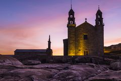 The Church of Virgen de la Barca, Muxia, Galicia, Spain. Church of Virgen de la Barca, Muxia, Galicia, Spain, shot at sunset, lots of purple in a gorgeous sky stock photos