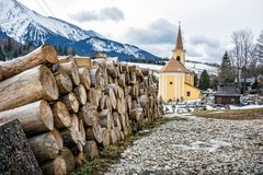 Church of Virgin Mary Visitation and wooden beams in Zdiar, Slov Stock Images
