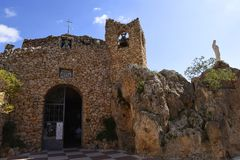 Church of the virgin of the Rock in Mijas in the Mountains above the Costa del Sol in SpainDonkey in. Mijas is one of the most beautiful `white` villages of the stock image