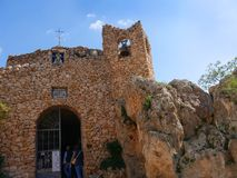 Church of the virgin of the Rock in Mijas in the Mountains above the Costa del Sol in SpainDonkey in. Mijas is one of the most beautiful `white` villages of the stock photography