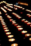 Church Votive Candles. Group of votive candles tea light in a church on a dark background stock photo