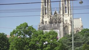 Church vow in the city of Vienna view from the bus. VIENNA, AUSTRIA - MAY 2018 Votivkirche in the city of Vienna view from the sightseeing bus stock footage