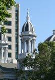 Church Vs Building. Church next to business building Stock Photos