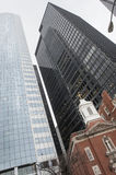 Church vs skyscraper. The great contrast between a sky and a Catholic church Royalty Free Stock Images