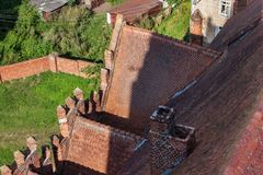 Aerial view of red tile roof of the Church of St. Great Martyr George the Victorious in Pravdinsk Friedland, Russia. The Church was erected 1360-1380, rebuilt Royalty Free Stock Photography