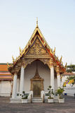 Church in Wat Pho decorated in gold and red. Orange and green roofs Stock Photos