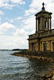 Church by the water. The preserved church at Rutland Water, Leicestershire,England. This church was saved when several villages were flooded to create this stock image