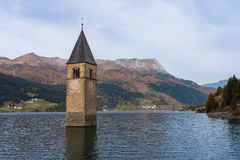 Church in the water at Lake Reschen in Tyrol in north Italy royalty free stock photos