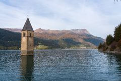 Church in the water at Lake Reschen in Tyrol in north Italy royalty free stock images